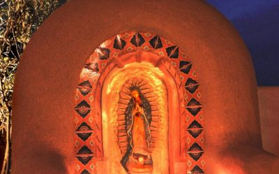 Adobe Shrine to Our Lady of Guadalupe with candles